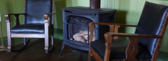 Relax by the wood stove in the lobby of the Dauphine Hotel